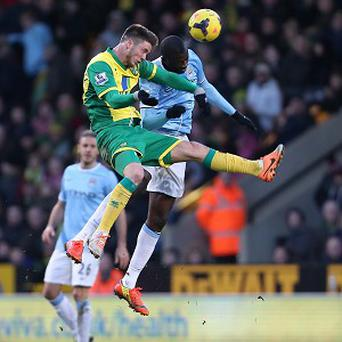 Yaya Toure, right, appeared to kick Ricky van Wolfswinkel, left, in Saturday's goalless draw at Carrow Road