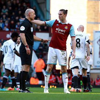 Andy Carroll is banned for West Ham's match against Norwich on Tuesday