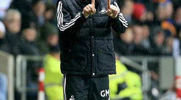 Garry Monk is merely focused on keeping Swansea in the Premier League