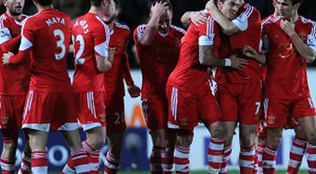 Jose Fonte, centre, right, celebrates scoring the only goal of the game