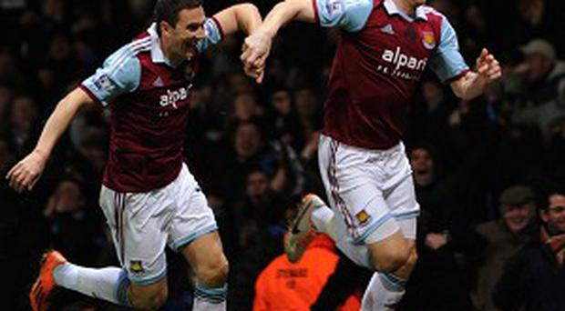 James Collins, right, celebrates after opening the scoring
