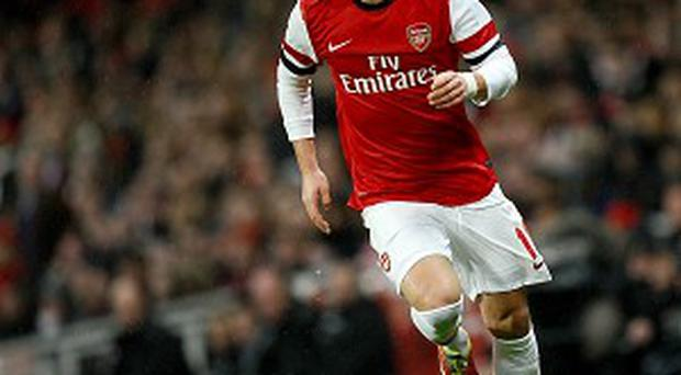 Mesut Ozil is under no illusions over the size of the task facing the Gunners.
