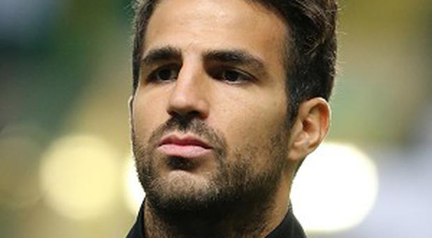 Barcelona's Cesc Fabregas was flattered by Manchester United's interest in him