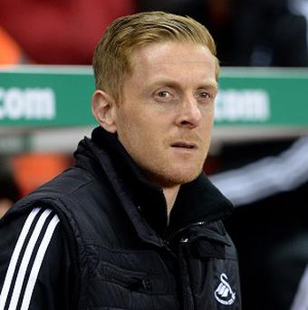Garry Monk, pictured, has received praise from former Swansea boss Brendan Rodgers