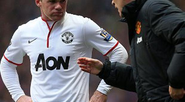 Wayne Rooney, left, has signed a new contract that will keep him at Old Trafford until 2019
