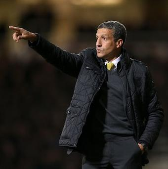 Chris Hughton's Norwich host Tottenham at Carrow Road on Sunday