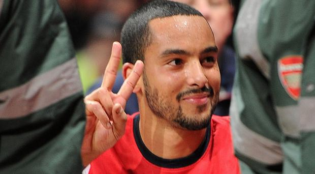 Theo Walcott is taking his time as he looks to recover from a cruciate ligament injury