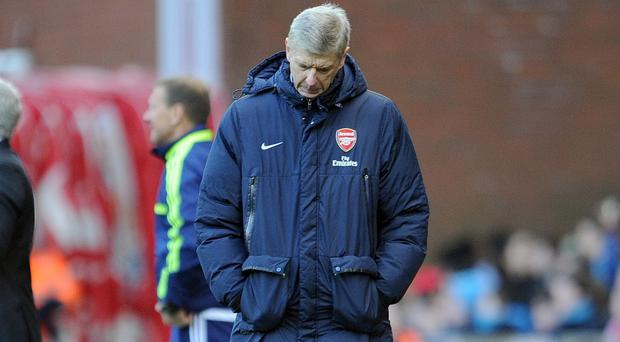 Arsene Wenger's title aspirations took a major dent