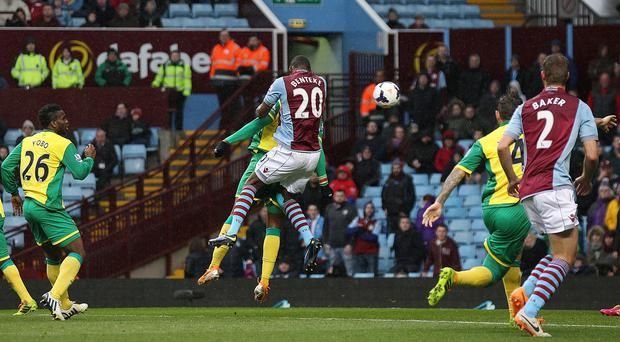 Christian Benteke, centre, heads in his second goal