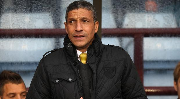 Chris Hughton expects a reaction from his players following Sunday's defeat at Villa Park