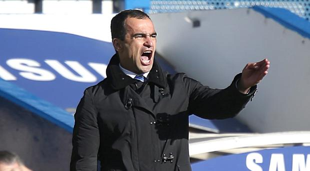 Roberto Martinez has told Everton players to forget about the World Cup or contract issues and concentrate on their remaining 11 league matches