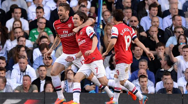Tomas Rosicky, centre, scored a stunning opening goal against Spurs this season