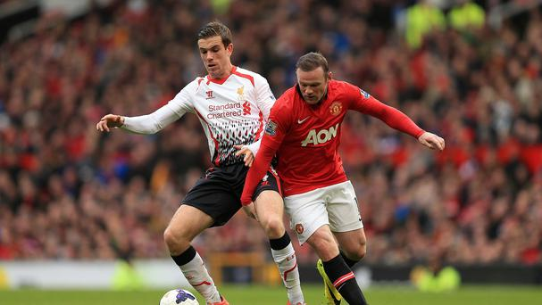 Liverpool's Jordan Henderson, left, says the Reds must not dwell on their win over Manchester United
