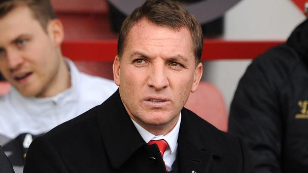 Steven Gerrard wants Brendan Rodgers, pictured, to stay at Liverpool for a long time