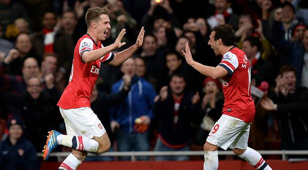 Aaron Ramsey, left, and Santi Cazorla have signed new deals at Arsenal