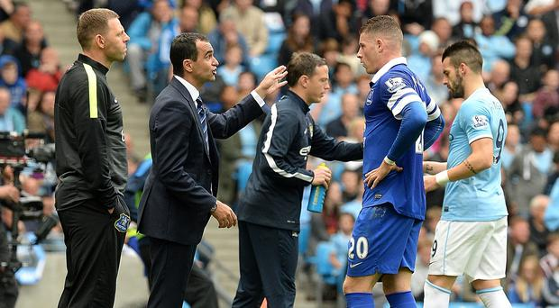 Everton midfielder Ross Barkley, second right, claims Roberto Martinez is a more tactical manager than former boss David Moyes