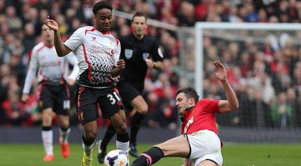 Raheem Sterling, left, has started 18 of Liverpool's 20 matches since December 1