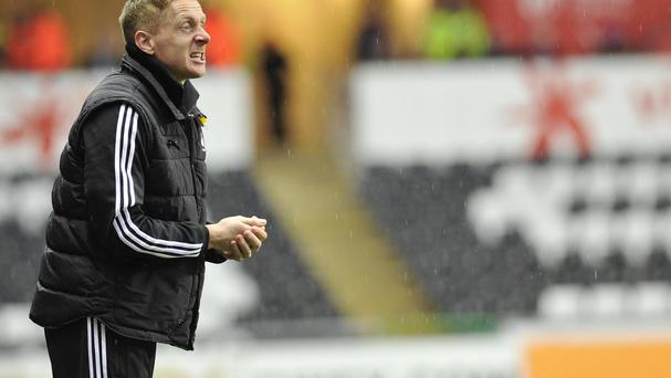 Swansea City manger Garry Monk says his team are up for the challenge