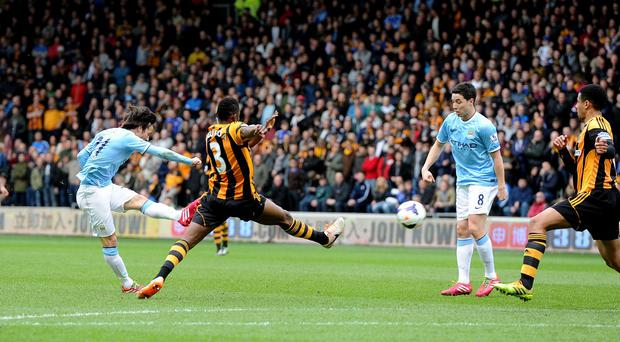 David Silva's fine goal against Hull helped Manchester City pick up a valuable three points in the title race