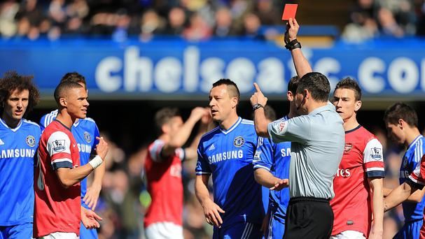 Referee Andre Marriner showed a red card to Arsenal's Kieran Gibbs
