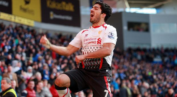 Brendan Rodgers hailed Luis Suarez, pictured