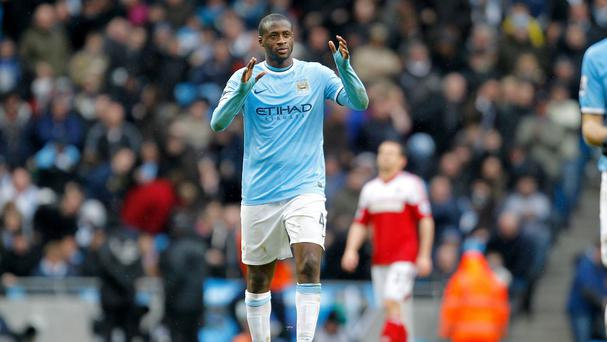 Yaya Toure scored a hat-trick in Manchester City's rout of Fulham