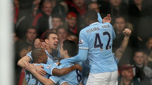 Manchester City's Edin Dzeko celebrates with team mates after scoring his side's first goal of the game