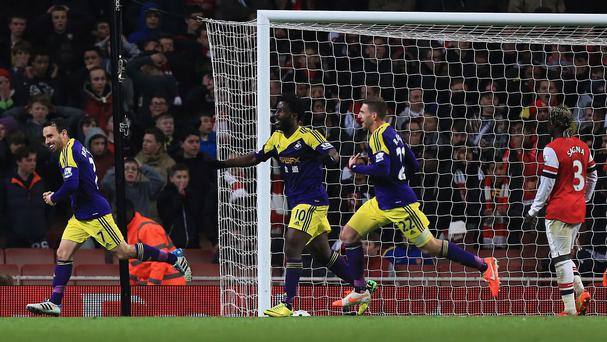Swansea grabbed a dramatic late equaliser to earn a 2-2 draw at Arsenal on Tuesday night