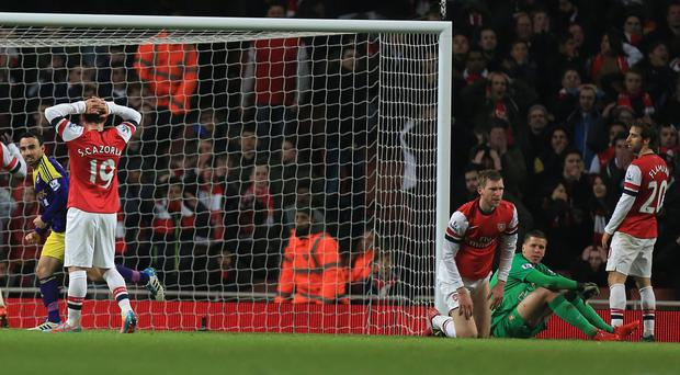 Mathieu Flamini, right, scored the own goal which gave Swansea a point