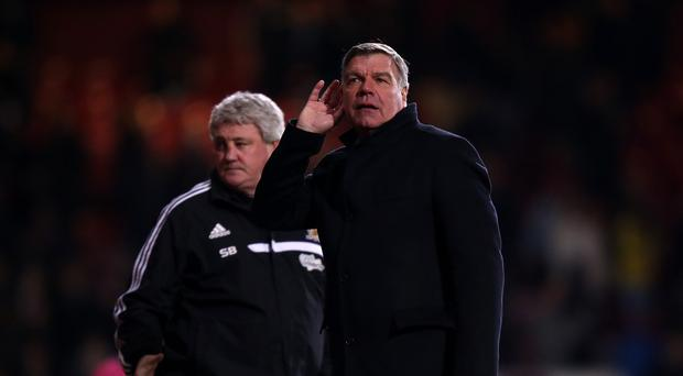 West Ham manager Sam Allardyce puts his hand to his ear to listen to the crowd after the end of the game