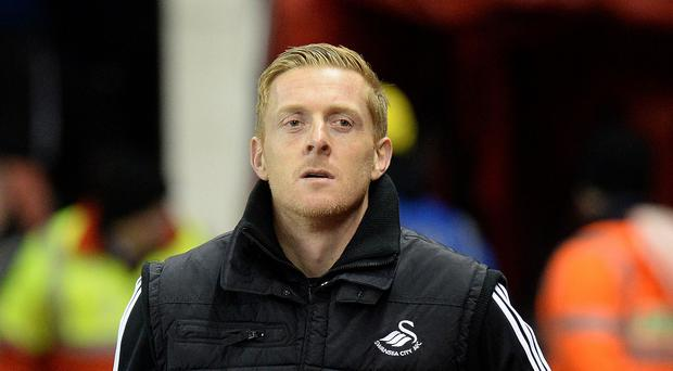 Swansea head coach Garry Monk, pictured, is not thinking about his own position