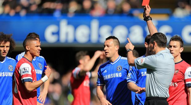 Referee Andre Marriner has been criticised for showing a red card to the wrong player