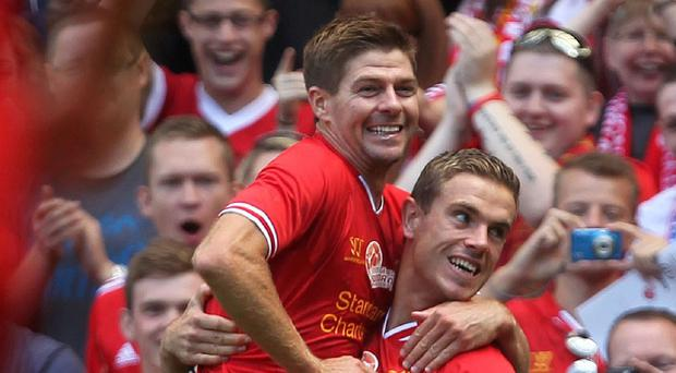 Steven Gerrard, left, is aiming toclaim an elusive Premier League winner's medal