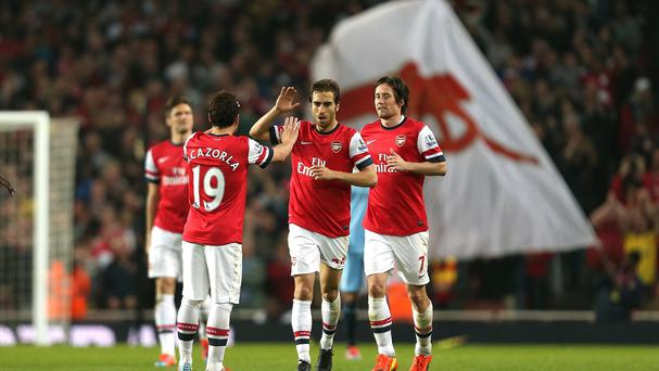 Mathieu Flamini celebrates scoring the equalising goal