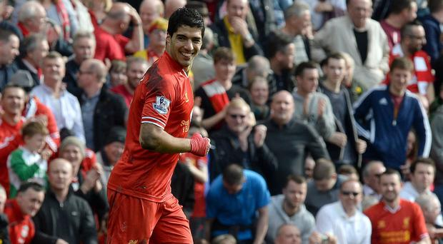 Luis Suarez celebrated yet another goal as Liverpool went top