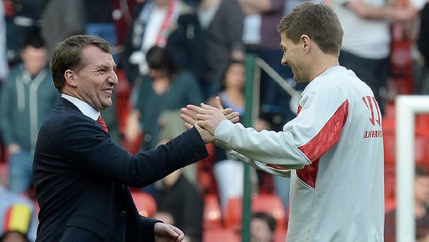 Brendan Rodgers, left, and his Liverpool side are closing in on a remarkable title triumph