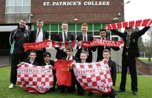Proud pupils: PE teacher Tony McAuley and pupils at St Patrick's College show their support for former pupil Brendan Rodgers and his Liverpool side