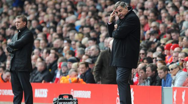 Sam Allardyce (right) believes counterpart Brendan Rodgers (left) and his Liverpool side are benefiting from their commitment to star striker Luis Suarez