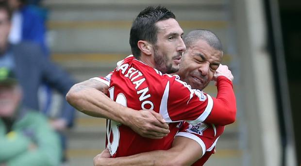 Morgan Amalfitano, left, celebrates scoring the winner with Steven Reid, right
