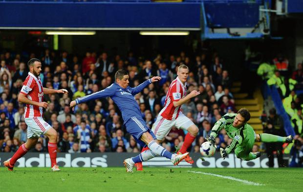 Asmir Begovic of Stoke City saves a shot from Chelsea's Fernando Torres during their Premier League encounter at Stamford Bridge. Photo: Mike Hewitt