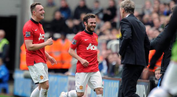 Juan Mata, centre, bagged a brace against Newcastle