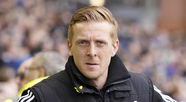 Garry Monk, pictured, comes up against Jose Mourinho for the first time on Sunday
