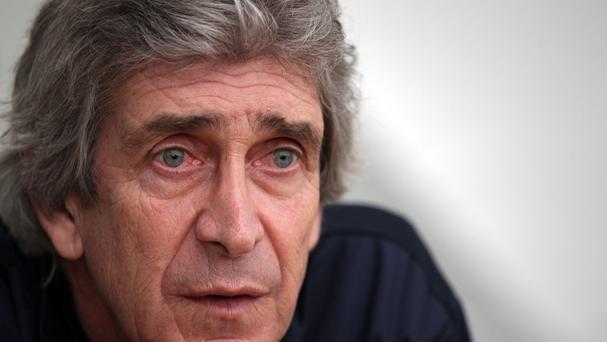 Manchester City manager Manuel Pellegrini is enjoying the pressure of competing for the title
