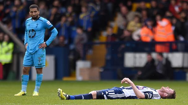 West Bromwich Albion's Chris Brunt, right, is left dejected after the final whistle
