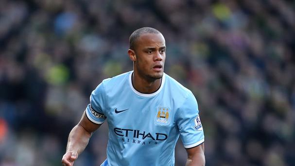 Vincent Kompany gave Manchester City an injury scare ahead of their crunch trip to Liverpool