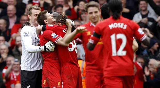 Steven Gerrard, second left, celebrates with his team-mates following Liverpool's win over Manchester City