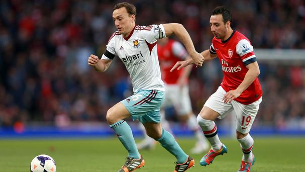 West Ham United's Mark Noble (left) gets away from Arsenal's Santi Cazorla as they battle for the ball
