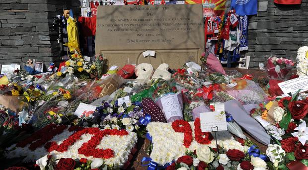 Floral tributes were left at Hillsborough and Anfield to mark the 25th anniversary of the Hillsborough disaster