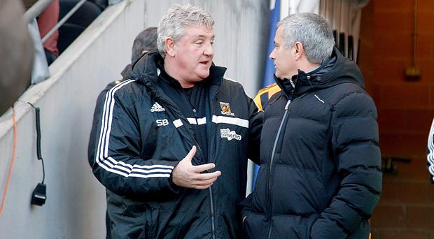 Steve Bruce, left, was happy to see Hull's game against Arsenal moved to accommodate Chelsea