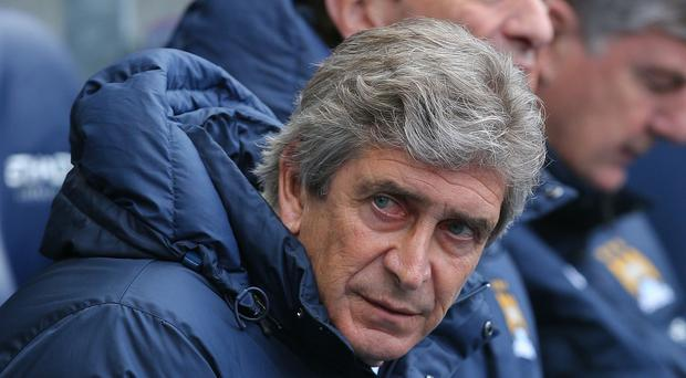 Manuel Pellegrini's Manchester City are third in the Premier League with five more games to play